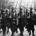 The confident French march off to war
