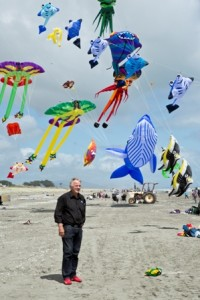 Mayor Ross Church, resplendent in red 'Dorothy' shoes, admires the kite flight