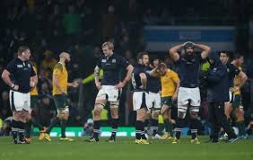 The dejected Scots after their last minute loss