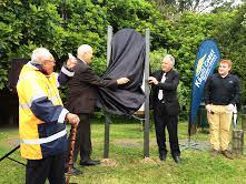Council's Kaumātua Rakauoteora Te Maipi (Koro Don), David Hadfield (son of Barry Hadfield), Mayor Ross Church and Council's Recreation Facilities Coordinator Mark Hammond unveiling a Heritage Trail sign at the renaming of the Barry Hadfield Nikau Reserve event this afternoon. Photo credit: Kāpiti Coast District Council