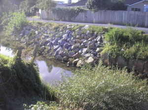 The north bank shored up with rocks after the May floods last year