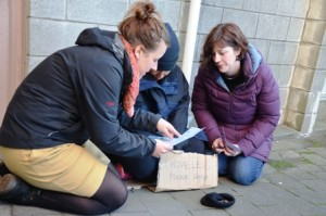 City Mission workers get down to basics with a street beggar in Wellington
